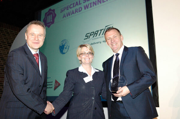 Rachel Morley of Spatial Global receives the 2010 BIFA Special Services award from (left) Russell Woodward of sponsor Forward Computers and (right) event host Graham Poll – the former international football referee