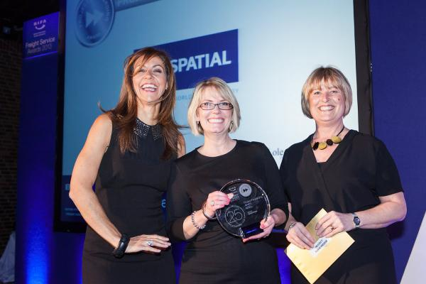 Left to right: Television presenter Julia Bradbury presents Rachel Morley of Spatial Global with the BIFA Award in the presence of Tracey Meaney from sponsor Peter Lole & Co.
